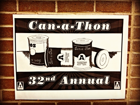 Can-a-thon posters are hanging all around the school as a reminder to bring in cans!