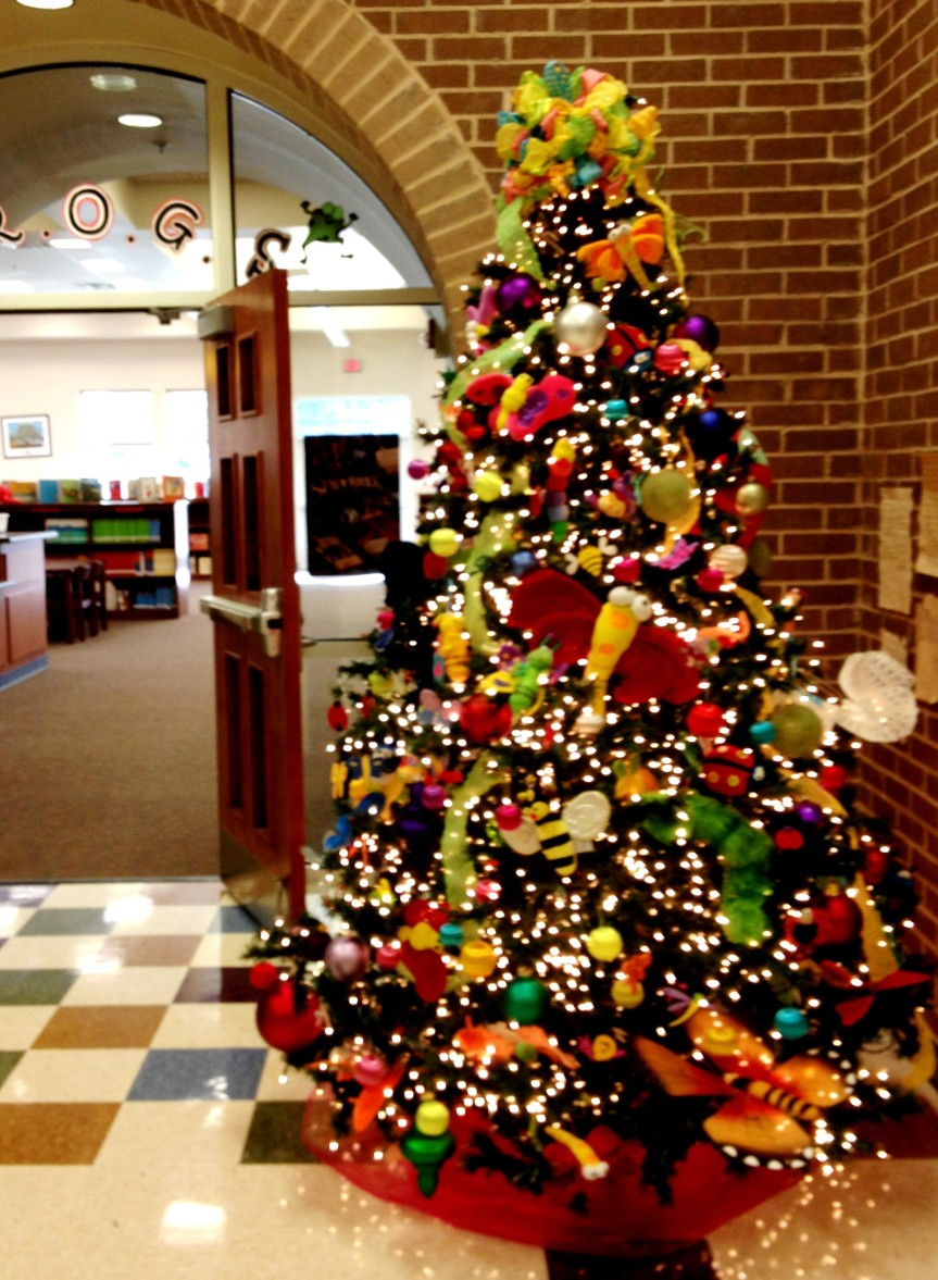 One of our school's holiday traditions: a cute Christmas tree covered with colorful bugs